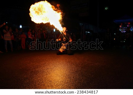 Chiang Mai, Thailand - November 6: fire sword dance, The arts of the ancient Lanna or ancient people of northern Thailand. in the Loy Krathong festivals on November 6, 2014, in Chiang Mai, Thailand.