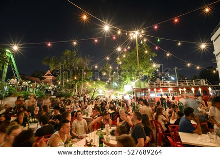 CHIANG MAI THAILAND - NOVEMBER 14, 2016 : Full Moon day , Unidentified many tourists book table to celebrate & watch the spectacle of the full moon. tonight's match with Thailand's Loy Krathong.