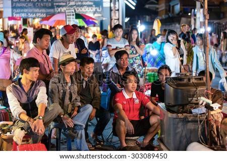 CHIANG MAI, THAILAND - NOVEMBER 15, 2014: Group of people watching football game, Chiang Mai, Thailand. - stock photo