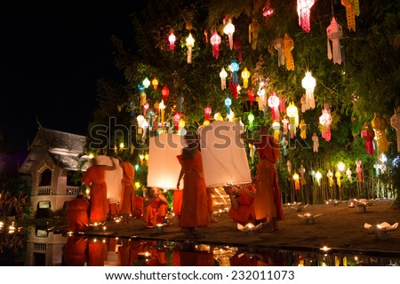 CHIANG MAI THAILAND-NOVEMBER 7 : Loy Krathong festival in Chiangmai.Tradition al monk lights floating balloon made of paper annually at Wat Phan Tao temple.On November 7,2014 in Chiangmai,Thailand.