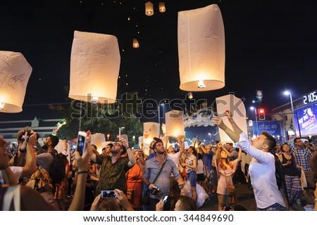 CHIANG MAI THAILAND - NOVEMBER 25 : Loy Krathong festival. Unidentified tourist lights floating lanterns made of paper annually Loy Krathong Festival. on November 25, 2015 in Chiang Mai, Thailand. - stock photo