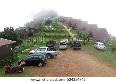 CHIANG MAI, THAILAND - NOVEMBER 8, 2016 Mon Cham mountain landscape and resort cottage, village, farmland, fog in Chiang Mai, Thailand