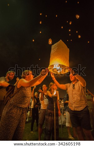 CHIANG MAI,THAILAND-November 25:People release sky lanterns to worship Buddha's relics in Yi Peng festival on November 25,2014 in Chiangmai,Thailand.