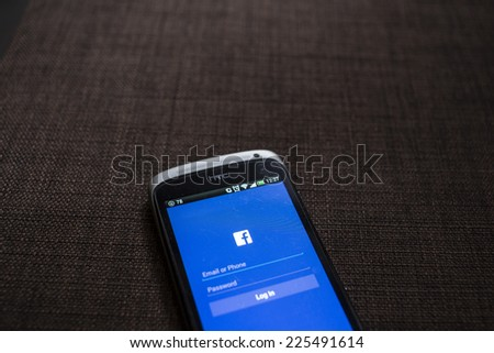 CHIANG MAI, THAILAND - OCTOBER 21, 2014: Facebook application sign in page on Htc One S smartphone. Facebook is largest and most popular social networking site in the world. - stock photo
