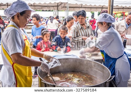 CHIANG MAI, THAILAND - OCTOBER 13: People waited to be taken vegetarian food during vegetarian food festival as following the traditional Chinese calendar, October 13, 2015 in Chiang mai, Thailand. - stock photo