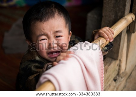 CHIANG MAI,THAILAND - OCTOBER 18: Unidentified boy are crying of Hmong hill tribe in Chiang Mai Province on October 18,2015 in Doi Inthanon,Chiang Mai,Thailand
