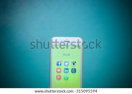 CHIANG MAI, THAILAND - SEPTEMBER 02, 2015: All of popular social media icons on smartphone device screen Apple iPhone 6 on blue background. - stock photo