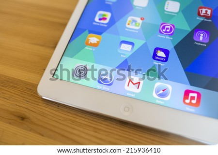 CHIANG MAI, THAILAND - SEPTEMBER 07, 2014: App store apple application on new Apple iPad Air device screen with wood background. - stock photo
