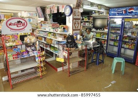 CHIANG MAI THAILAND - SEPTEMBER 28 : Flooding the Chiangmai city.Flood damage over a wide area stores on September 28,2011 in Chiangmai,Thailand