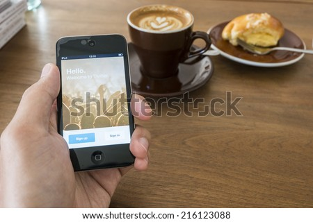 CHIANG MAI, THAILAND - SEPTEMBER 05, 2014: Twitter application login screen on iPod touch apple product device screen. - stock photo