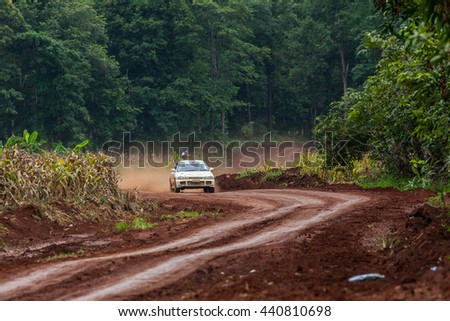 CHIANG MAI, THAILAND - September 06: Unknown car driver piloting his car on the tracks, September 06, 2015 in Chiang Mai, Thailand.