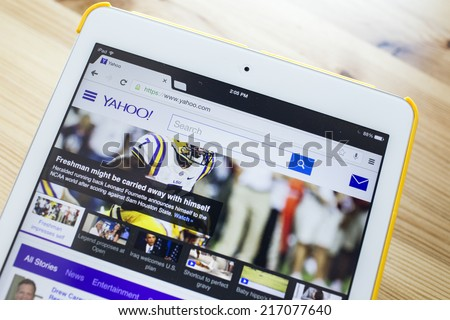 CHIANG MAI, THAILAND - SEPTEMBER 07, 2014: Yahoo.com website page using Apple iPad Air on September 7, 2014 in Chiang Mai, Thailand. - stock photo