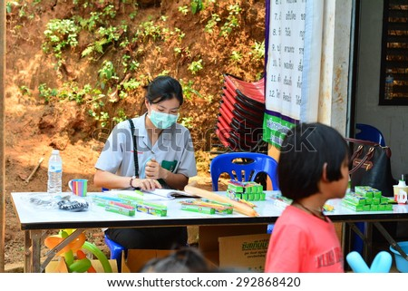 CHIANG RAI, THAILAND -APRIL 5 2015: Unidentified dentist volunteer from public hospital are in medical services at Ban La Ba school  on April 5,2015 in Chiang rai,Thailand. - stock photo