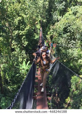chiang rai thailand august 9 vertical photo of unidentified people walking on canopy - Green Canopy 2016
