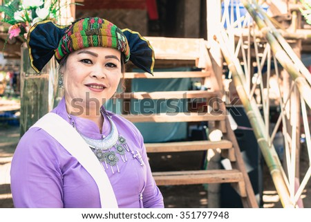 CHIANG RAI, THAILAND - DECEMBER 6 2015: Unidentified Tai Lue woman with traditional clothes and silver jewelry in hill tribe minority village on December 6, 2015. Chiang Rai, Thailand.