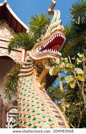 CHIANG RAI, THAILAND - FEBRUARY 13: Dragon sculpture at entrance to temple Ngam Muang, Chiang Rai, Thailand, February 13, 2014. Church was built in 1670  - stock photo