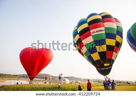 CHIANG RAI, THAILAND - FEBRUARY 13 : Hot air balloon in the sky at SINGHA PARK CHIANG RAI BALLOON FIESTA 2016 , Chiang rai province, Thailand - stock photo