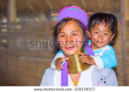 CHIANG RAI, THAILAND - JAN 2015: Karen tribal woman with her child near Mae Hong Son, Thailand, Chiang Rai. Padaung long neck hill tribe village, refugee community originate from neighboring Myanmar.