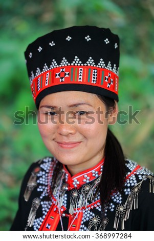 Chiang Rai, Thailand - Jan 23, 2016: Unidentified Hmong woman in Northern Thailand. indigenous tribe in the local market. The Hmongs are one of the largest ethnic minorities in Thailand. - stock photo