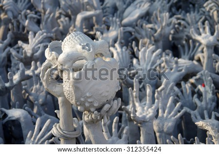 CHIANG RAI, THAILAND - January 19, 2015: Hand from hell statue in Wat Rong Khun