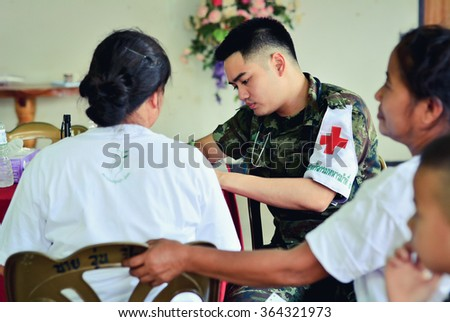 CHIANG RAI, THAILAND JUNE 6 2015: Unidentified military doctors from public hospital are in medical services at Ban Sop Kok city of Chiang Saen in Chiang rai,Thailand.