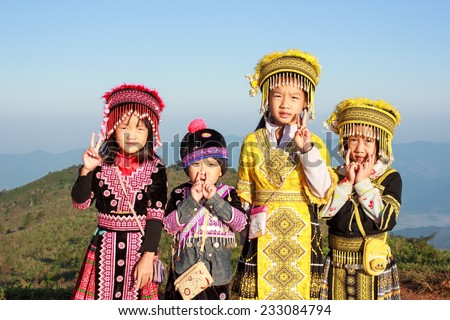 CHIANG RAI, THAILAND, NOVEMBER 22: Unidentified ethnic minority children in a traditional dress on November 22, 2014 in Chiang Rai, Thailand. Chiang Rai is a northernmost province in Thailand.  - stock photo