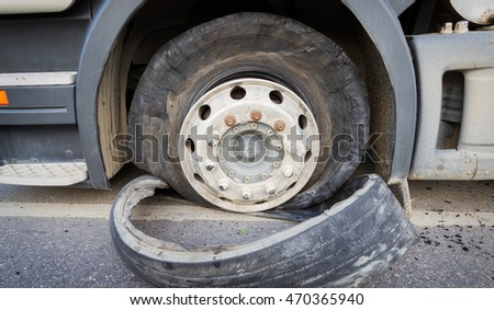 CHIANG RAI, THAILAND - SEPTEMBER 27 : closeup damaged 18 wheeler semi truck burst tires by highway street with unidentified driver standing beside on September 25, 2015 in Chiang rai, Thailand