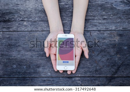 CHIANG RAI, THAILAND - SEPTEMBER 13, 2015: Woman try to log in  Google+ social network of the Google company. Information of a social network, influences Google search results. - stock photo