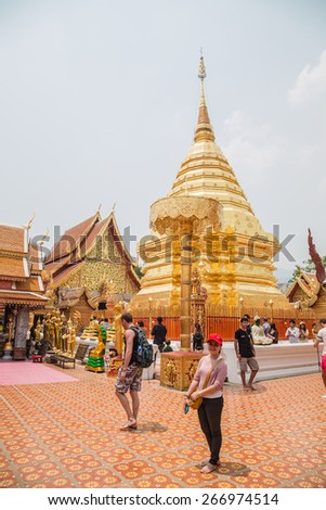 CHIANGMAI - APRIL 6: Locals and tourists come to pray at the Doi Suthep Temple in Chiang Mai, Thailand on April 6, 2015. The temple founded in 1385 is a major tourist attraction in Chiang Mai. - stock photo