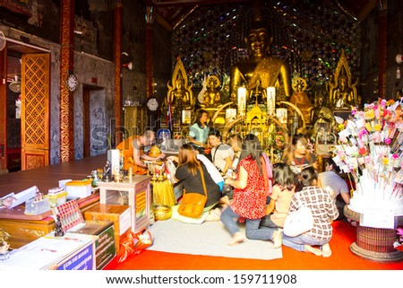CHIANGMAI - OCTOBER 14:Tourists come to pray at the Doi Suthep Temple in Chiang Mai, Thailand on October 14, 2013. The temple founded in 1385 is a major tourist attraction in Chiang Mai.