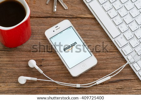 CHIANGMAI, THAILAND -APRIL 23, 2016:Apple iphone 4s to Amazon app. Amazon is an American international electronic commerce company. - stock photo