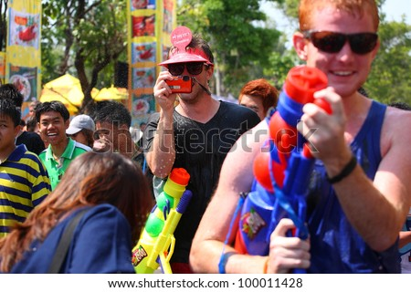 CHIANGMAI THAILAND-APRIL 13: Chiangmai Songkran festival.Foreign tourists and Thai people enjoy splashing water together around Tapae gate in Songkran festival. on April 13,2012 in Chiangmai,Thailand.