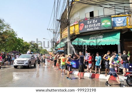 CHIANGMAI THAILAND-APRIL 12:Chiangmai Songkran festival.Foreign tourists started to splash water festival Loy Kroh Road. on April 12,2012 in Chiangmai,Thailand.