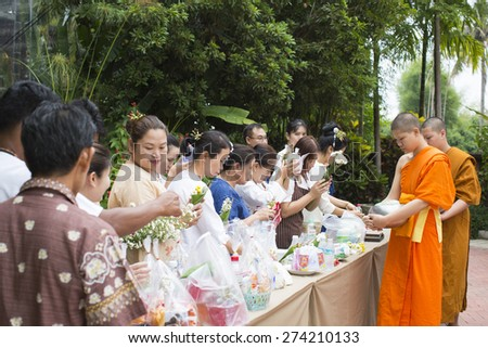 Chiangmai , THAILAND - April 13: People Give food offerings to a Buddhist monk, make merit on April 13, 2015 in Chiangmai, Thailand.