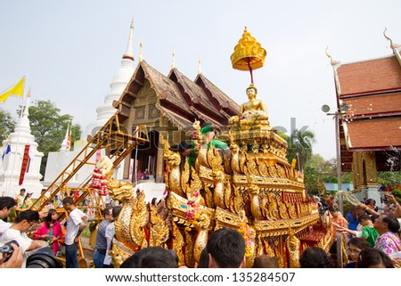 CHIANGMAI, THAILAND - APRIL 13: Phra Singh statue of Phra Singh temple was moved to the parade cars for pour water in Songkran Festival 2013 on April 13, 2013 in Chiang Mai, Thailand.