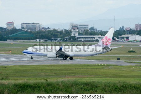 CHIANGMAI , THAILAND -AUGUST 18 2007: B-18607 Boeing 737-800 of China airline. On runway for Take off from Chiangmai airport to Taipei. - stock photo