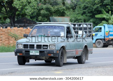CHIANGMAI , THAILAND - AUGUST 6 2015:  Drinking water delivery Pickup truck of Sahagorn company. Photo at road no.121 about 8 km from downtown Chiangmai, thailand.