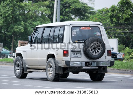 CHIANGMAI, THAILAND -AUGUST 13 2015:   Old Private White Mitsubishi Pajero Truck. Photo at road no.1001 about 8 km from downtown Chiangmai, thailand.