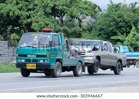 CHIANGMAI , THAILAND -AUGUST 6 2015:   SayThong Tow truck for emergency car move. Photo at road no 1001 about 8 km from downtown Chiangmai, thailand.