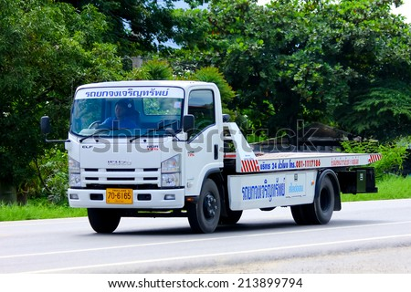 CHIANGMAI , THAILAND - AUGUST 22 2014:  Slide up tow truck for emergency car move of Jongjareun sab company. Photo at road no 121 about 8 km from downtown Chiangmai, thailand. - stock photo