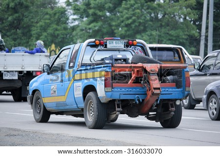 CHIANGMAI, THAILAND -AUGUST 14 2015:  Tow truck for emergency car move, Bangkok Slide on Company. Photo at road no.1001 about 8 km from downtown Chiangmai, thailand. - stock photo