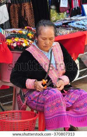 CHIANGMAI THAILAND-DECEMBER 27 :A Women Akha doing her needlework in home. on December  27, 2013 in Chiangmai, Thailand