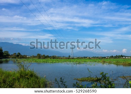ChiangMai, Thailand. December, 03-2016 : Electricity poles have been located in urban area of Chiang Mai city surrounded by spectacular environment.