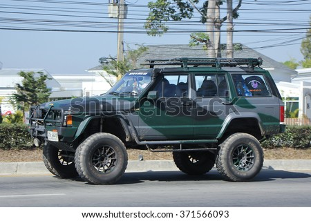 CHIANGMAI, THAILAND -DECEMBER 12 2015:  Private jeep car. Photo at road no.121 about 8 km from downtown Chiangmai, thailand.