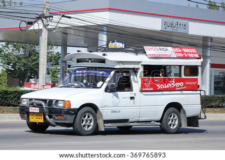 CHIANGMAI, THAILAND -DECEMBER 1 2015:  White Pick up truck taxi chiangmai, Service between city and Sankampeng district. Photo at road no.121 about 8 km from downtown Chiangmai, thailand.