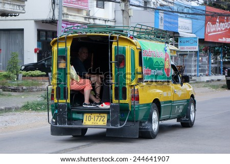 CHIANGMAI, THAILAND - DECEMBER 3 2014:   Yellow and Green taxi Lampang, Service in city and around. Photo at road no.11 about 3 km from downtown of Lampang, thailand.