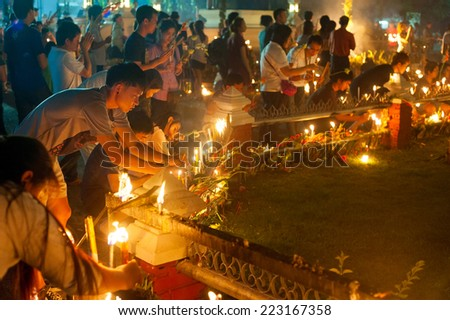 CHIANGMAI, THAILAND- Feb 14, 2013: Unidentified people lights candles at Wat Phan Tao Temple, Chiangmai