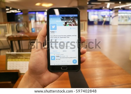 CHIANGMAI, THAILAND -FEB 14,2017:Women hand holding smartphone and using Twitter application,Twitter is an online social networking.