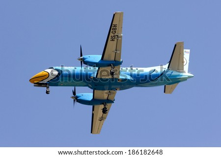 CHIANGMAI, THAILAND - FEBRUARY  5 2014: HS-GBH  Saab340 of Nokmini airline ( Nokair) , landing to Chiangmai airport from Mae sot.