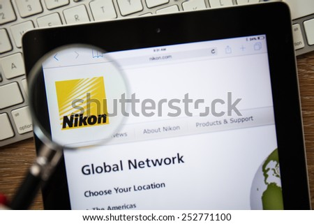 CHIANGMAI, THAILAND - FEBRUARY 15, 2015: Photo of Nikon.com homepage on a apple ipad screen. - stock photo